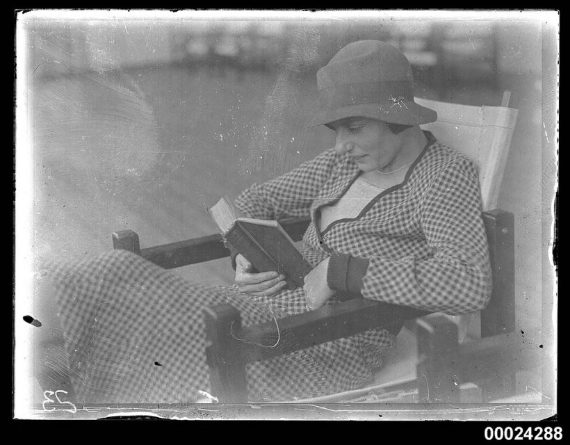 Portrait of a woman seated and reading possibly on board SS TANDA -- from the Australian Maritime Museum